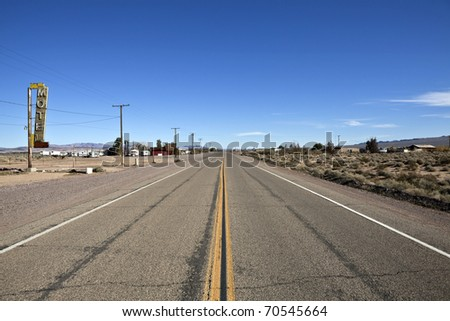 Decayed portion of historic Route 66 in the middle of California's vast Mojave desert.