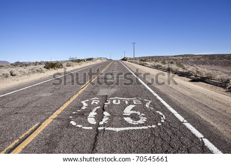Decayed section of historic Route 66 through California's vast Mojave desert.