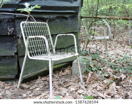 Decaying chairs abandoned in the forrest #1387628594