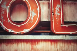 Decaying detail of vintage neon sign and letters abstract background