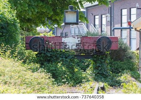 decaying railroad bumper stop...