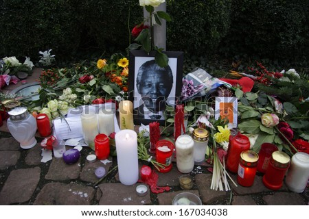 DECEMBER 12, 2013 - BERLIN: mourning for Nelson Mandela: flowers, candles and images at the South African Embassy in Berlin. - stock photo