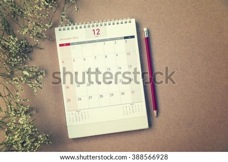 December Calendar 2016 and old flower on wood table ,vintage filter #388566928