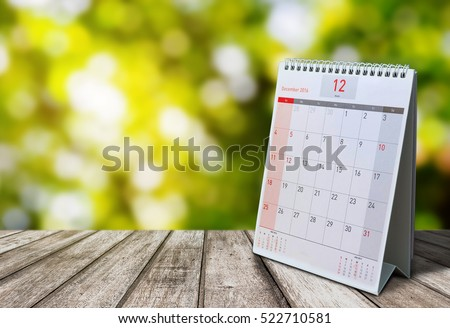 December Calendar  2016  on wood table with Beautiful Nature Bokeh.Blurred background