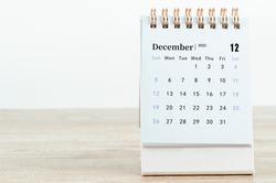 December Calendar 2021 on wooden table background.