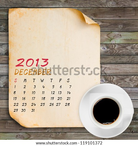 December 2013 Calendar, Vintage paper with Black coffee on wood panels background