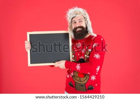 December holidays. Happy hipster hold empty blackboard. December school activities. Winter holidays. December 25. Christmas eve. December holiday program, copy space.