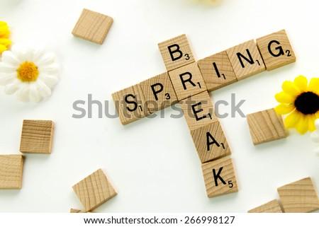 December 19, 2014: Houston, TX, USA (Illustrative Editorial) - Scrabble word game wood tiles spelling Spring Break