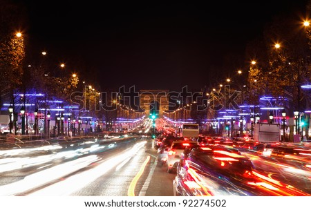 December illumination and traffic lights on the Avenue des Champs-?lys?es in Paris,Europe.