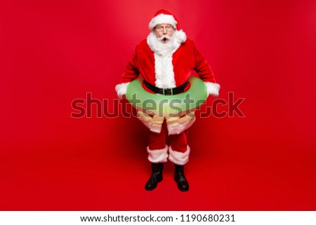December noel eve sale discount pool party. Full legs body size aged mature grandfather funny Santa tradition costume headwear spectacles white beard isolated red background open mouth staring eyes #1190680231