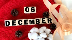December 6 on wooden cubes .Next to the cones, cotton and tape.Winter.Calendar for December.