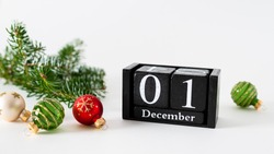 December 1st. Day 1 of december month, calendar with christmas balls decoration and fir branches on white background. Winter time. New year, hello winter holidays concept. Horizontal