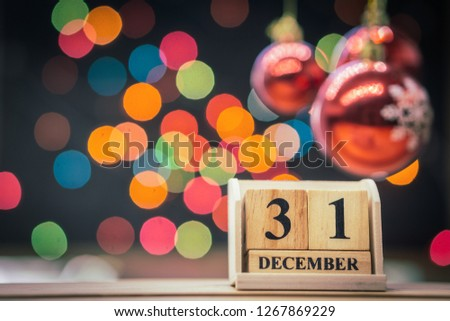 December 31st. Day 31 of December set on wooden calendar with bokeh background