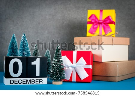 December 1st. Image 1 day of december month, calendar at christmas and new year background with gifts and little Christmas tree