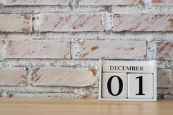 December 1st. Image of december 1 wooden color calendar on white brick wall background. empty space for text.