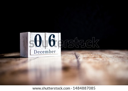 December 6th, 6 December, Sixth of December - White block calendar on vintage table - Date on dark background