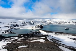 Deception Island is an island in the South Shetland Islands archipelago, with one of the safest harbours in Antarctica.