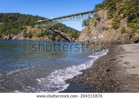 Deception Pass State Park, Washington. The Deception Pass Bridge is a two-lane bridge on Washington State Route 20 connecting Whidbey Island to Fidalgo Island in the U.S. state of Washington.