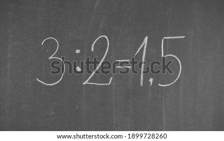Decimal notation. Division of numbers in mathematics, shown on the school board.                             Photo stock ©