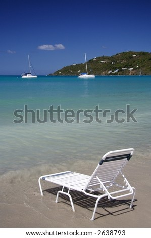 Deck chair on a caribbean beach