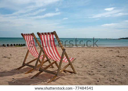 deck chair on beach in Swanage, England #77484541