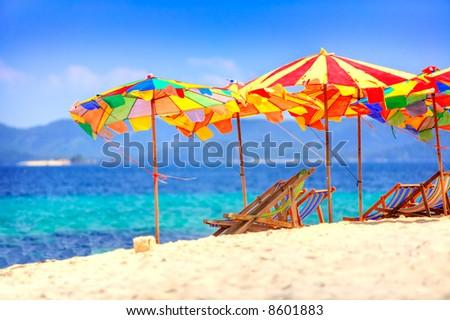 Deck chairs and umbrellas overlooking Thai beach