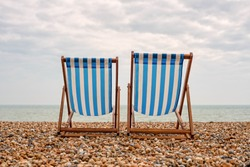 Deck chairs on the beach in Brighton