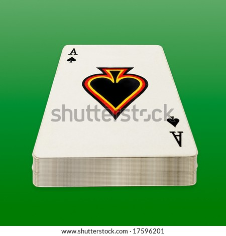 Deck of poker cards on green background, clipping path.