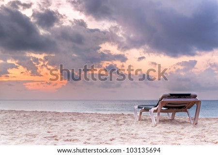 Deckchair on the Caribbean Sea at sunrise