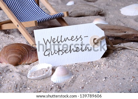 Deckchair, sand and label with lettering wellness coupon/beach/holiday