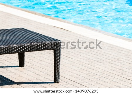 Deckchairs, chairs luxury swimming pool blue water for relaxation on summer travel vacation on the beach. Relaxing trip concept