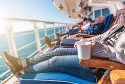 Deckchairs Cruise Ship Relax. Cruise Guest Relaxing in the Sun. Commercial Maritime Theme.