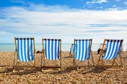 Deckchairs on Brighton beach. Brighton, East Sussex, England