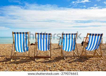 Deckchairs on Brighton beach. Brighton, East Sussex, England ストックフォト ©