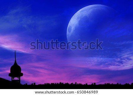 Decline over the city .  Sunset and new moon . Night city . Ramadan kareem background .mosque silhouette . Abstract religious  background with mosque . full moon . Ramadan kareem background