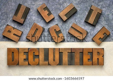 declutter word in vintage letterpress wood type against handmade textured amate paper, inspiration, motivation, simplicity, minimalism and lifestyle concept