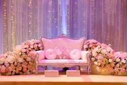 Deco with flower and The pelamin or wedding dais is specially created in a traditional Malay wedding.It is usually grandly designed and gaily decorated.