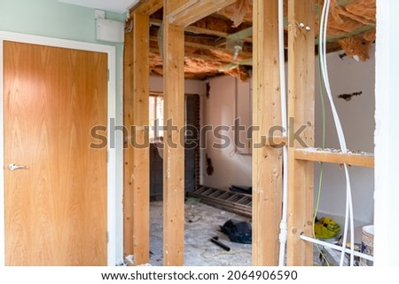 Deconstruction of room and garage with removing walls. No ceiling and floor. Big renovation project, wall removal and opening