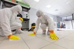 Decontamination of a room after an incident. Practical exercises during a training session on asbestos risk prevention, sample preparation room of an asbestos laboratory
