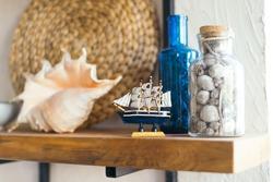 Decor on kitchen shelves.  Ship. Marine theme. Bright interior of the kitchen.  Shell.  nautical decor