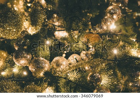 Decorated and illuminated christmas tree, vintage toning stock photo