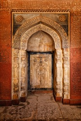 Decorated arch inside Isa Khan tomb, Humayun's Tomb complex, in Delhi, India