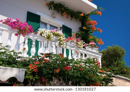 Decorated balcony, mediterranean climate flora and architecture