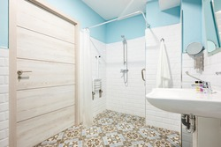 Decorated bathroom adapted for disabled people. Contemporany accessibility indoor architecture