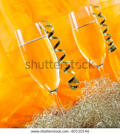 decorated champagne glass on table