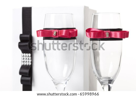 stock photo Decorated champagne glasses with a invitation for a wedding in