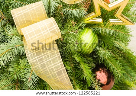 Decorated Christmas arrangment with ribbon and ornaments