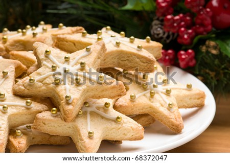 Decorated christmas cookie in festive setting with tree decoration