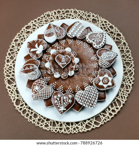 Decorated christmas gingerbread on light brown background.  #788926726