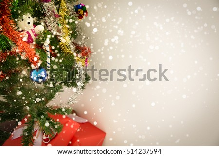 Decorated Christmas tree and gift box with lighting on toned background #514237594